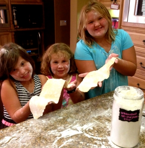 My daughter and two of her best friends making pasta and having fun. Priceless!